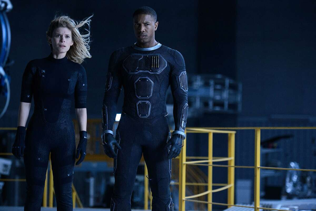 """This photo provided by Twentieth Century Fox shows, Kate Mara, left, as Sue Storm, and Michael B. Jordan as Johnny Storm, in a scene from the film, """"Fantastic Four,"""" releasing in U.S. theaters on Aug. 7, 2015. The Fox panel is held on Saturday, July 11, 2015, at the San Diego Convention Center during the Comic-Con International. (Ben Rothstein/Twentieth Century Fox via AP)"""