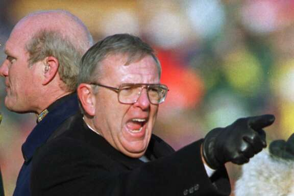 FILE - In this Jan. 12, 1997, file photo, Ron Wolf, general manager of the Green Bay Packers, points to the crowd during trophy presentation ceremonies after the Packers beat the Carolina Panthers 30-13 in the NFC championship NFL football game  in Green Bay, Wis. When the Packers were searching for someone to help rekindle the glory of the Lombardi years, they turned to Wolf. He turned them back into a powerhouse, and now he has been rewarded with election to the Pro Football Hall of Fame. (AP Photo/Mark Duncan, File)