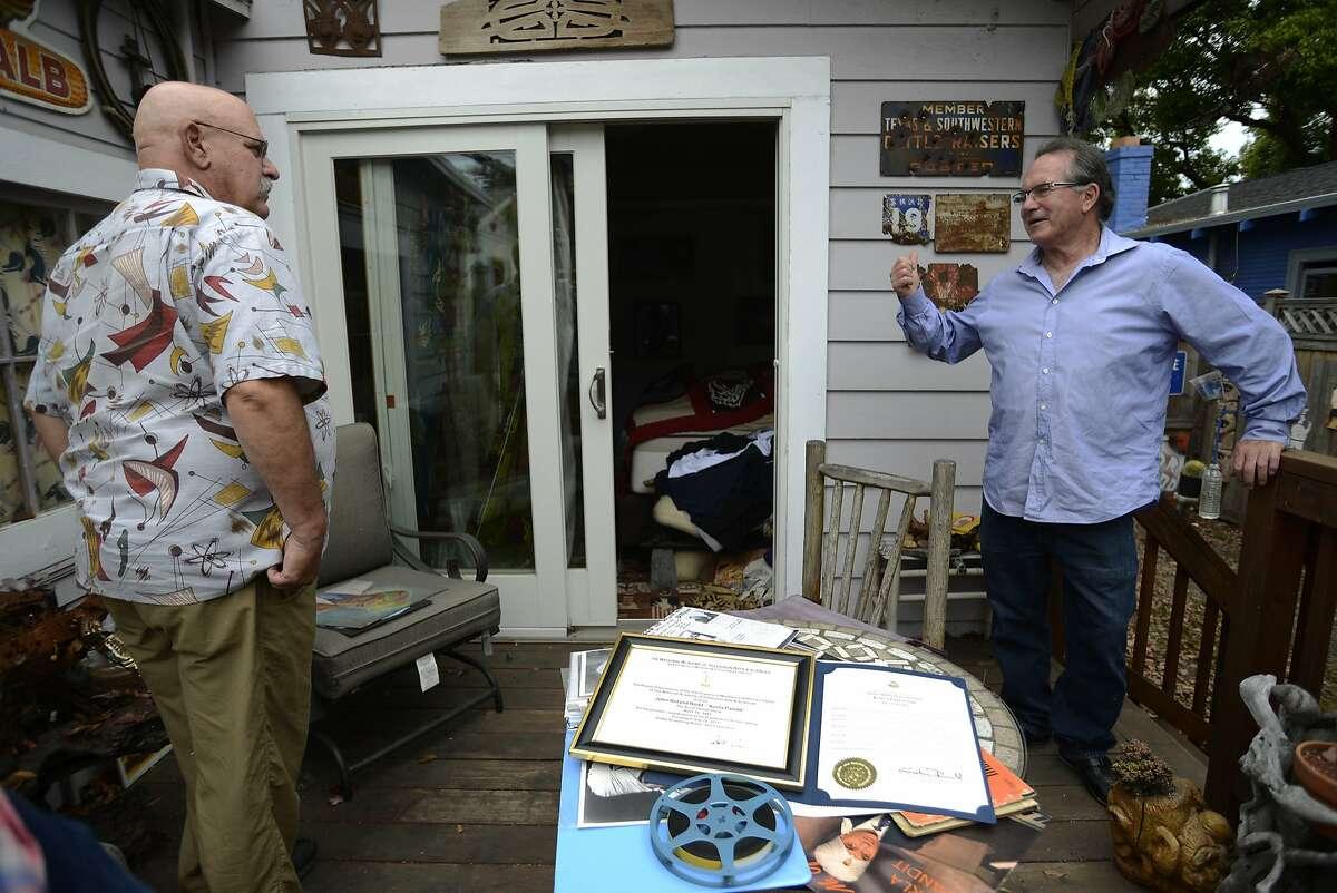 John Turner, director of the new documentary Korla (left), goes through old memorabilia of Korla Pandit with Eric Christensen, producer (right), in Berkeley, California, on Tuesday, Aug. 4, 2015.