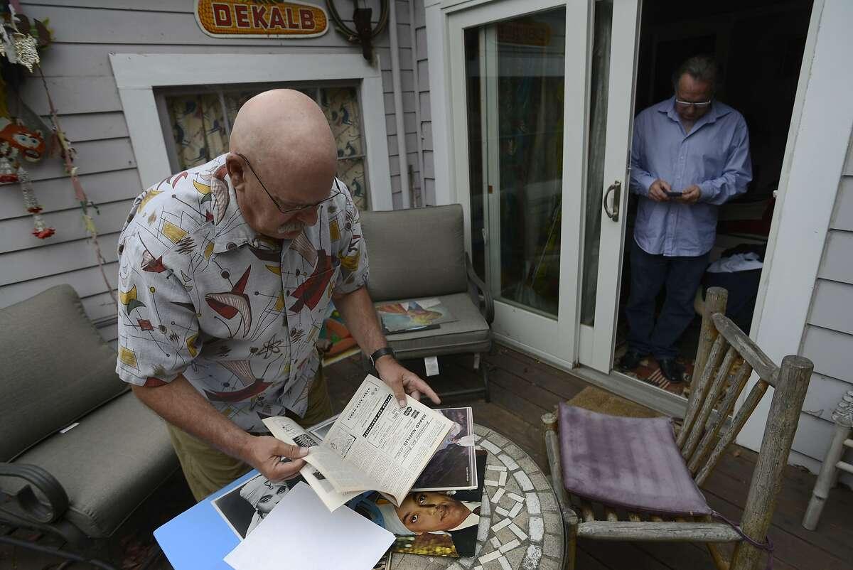 John Turner, director of the new documentary Korla (right), goes through old memorabilia of Korla Pandit with Eric Christensen, producer (right), in Berkeley, California, on Tuesday, Aug. 4, 2015.