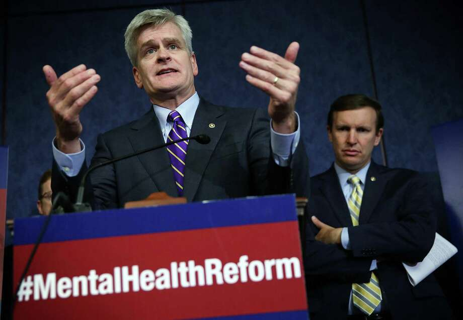 U.S. Sen. Bill Cassidy (R-LA) (L) speaks as Sen. Chris Murphy (D-CT) (R) listens during a news conference August 4, 2015 on Capitol Hill in Washington, DC. The lawmakers held the news conference to discuss the Mental Health Reform Act of 2015. Photo: Alex Wong / Getty Images / 2015 Getty Images
