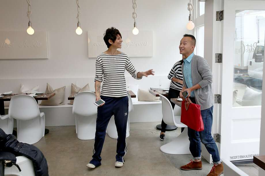 Chef/owner Dominique Crenn (left) talks with Kien Tran (right) an inquiring neighbor at Petit Crenn San Francisco, Calif., on Tuesday, August 4, 2015.  Petit Crenn is a neighborhood restaurant inspired by chef Dominique Crenn's mother, grandmother and her home in Brittany, France. Photo: Liz Hafalia, The Chronicle