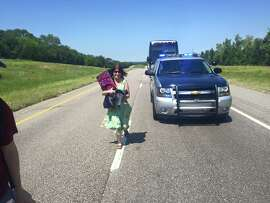 Rabbi Beth Singer, having fetched the Torah from car, runs to the front of the march from Selma, Ala., to Washington, D.C.