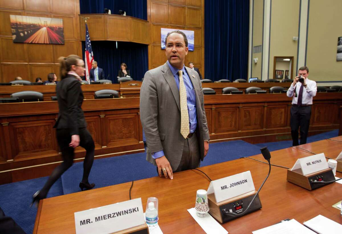 House Information Technology subcommittee Chairman Rep. Will Hurd, R-Texas arrives on Capitol Hill in Washington, Wednesday, March 18, 2015, before the subcommittee's hearing on Cybersecurity. (AP Photo/Pablo Martinez Monsivais)
