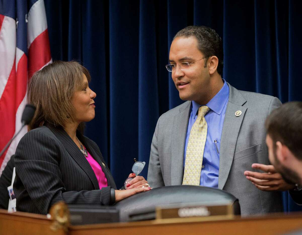 House Information Technology subcommittee Chairman Rep. Will Hurd, R-Texas, talks with Rep. Robin Kelly, D-Ill. on Capitol Hill in Washington, Wednesday, March 18, 2015, before the start of the subcommittee's hearing on Cybersecurity. (AP Photo/Pablo Martinez Monsivais) , left, before the start of a hearing on Cybersecurity on Capitol Hill in Washington, Wednesday, March 18, 2015. (AP Photo/Pablo Martinez Monsivais)