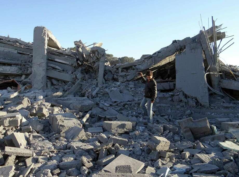 Debris are seen following a U.S.-led coalition air strike hits headquarters of Al-Nusra Front in Aleppo last year. Photo: Anadolu Agency / Anadolu Agency / Getty Images 2014 / 2014 Anadolu Agency