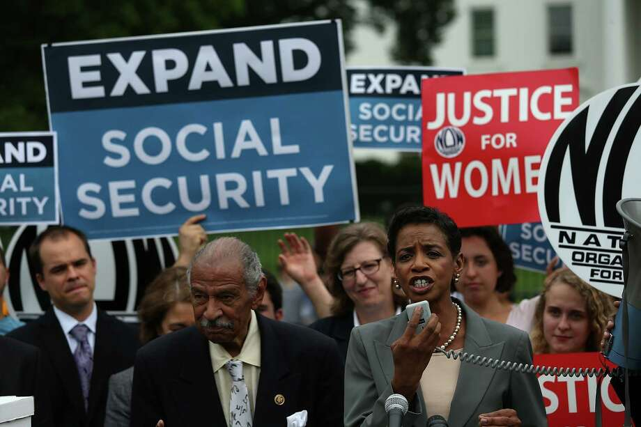 Rep. John Conyers, D-Mich., and Rep. Donna Edwards, D-Md., speak during a Washington rally last month urging the expansion of Social Security benefits. Photo: Win McNamee, Staff / 2015 Getty Images