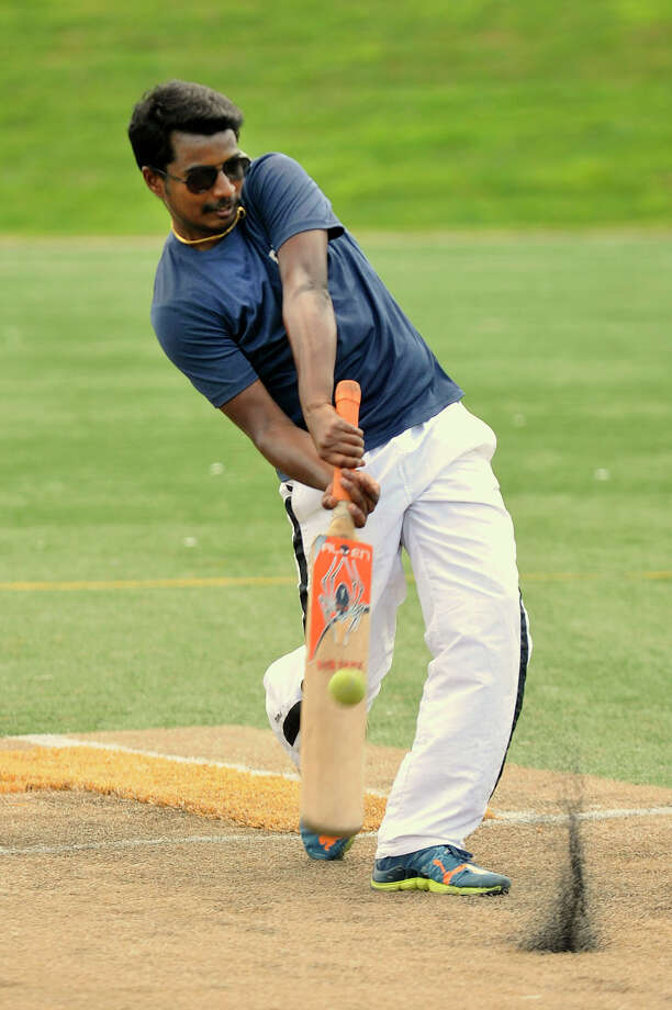 Striker Sathish Ranganathan connects with the ball during a practice session of cricket during his lunch break from RBS at Lione Park in Stamford, Conn., on Tuesday, Aug. 4, 2015. The team he is on, the T.B. Blasters, as in Transaction Banking Blasters, was practicing for their upcoming semifinal cricket match against another RBS team set for Friday, Aug. 7 at 7 p.m. at Lione Park. Photo: Jason Rearick / Hearst Connecticut Media / Stamford Advocate