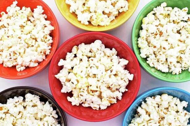 Popcorn in rainbow bowls.