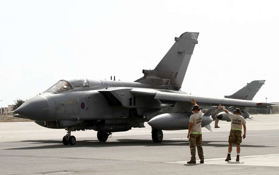 (FILES) A picture taken on September 27, 2014 shows a Royal Air Force Tornado GR4 fighter jet preparing to take off at the Akrotiri British RAF airbase near the Cypriot port city of Limassol. Britain is extending its air strikes against Islamic State (IS) group targets in Iraq by a year to March 2017, Defence Secretary Michael Fallon said in comments broadcast on August 4, 2015. The announcement represents a second reprieve for the squadron of ageing Tornado GR4 fighter bombers currently based in Cyprus which was due to be disbanded first this year and then next, and will now be kept on.  AFP PHOTO / STR-/AFP/Getty Images Photo: -, AFP / Getty Images