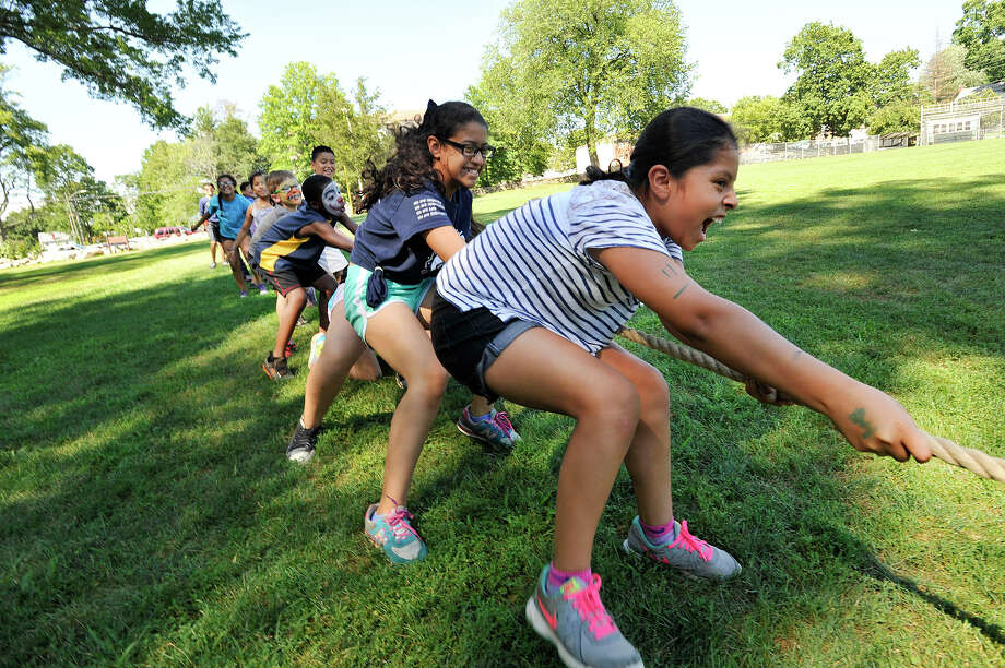 Belltown Camper Camila Villagomez, right, leads her tug of war team at Barrett Park in Stamford this week. This is the first year in six that Belltown Camp, a division of Stamford Parks and Recreation, has been based at Barrett. Belltown is one of six city camps throughout the city. On Friday, the campers hosted a family picnic and talent show. Photo: Jason Rearick / Hearst Connecticut Media / Stamford Advocate