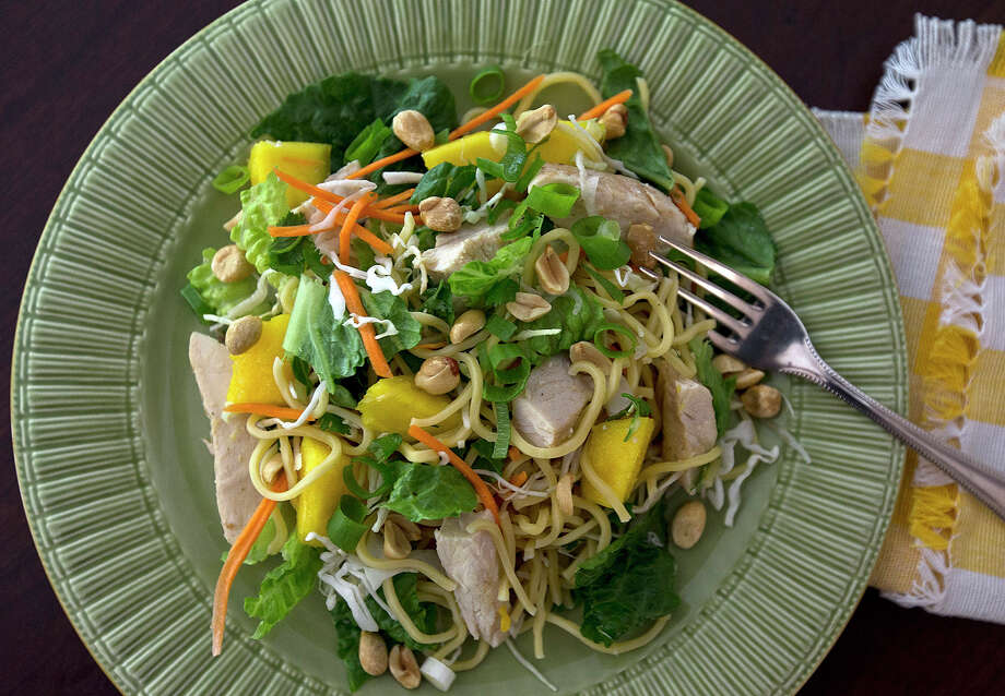Chinese Mango and Chicken Salad: A perfect way to use a bounty of fresh mangoes. Photo: Patrick Farrell /TNS / Miami Herald