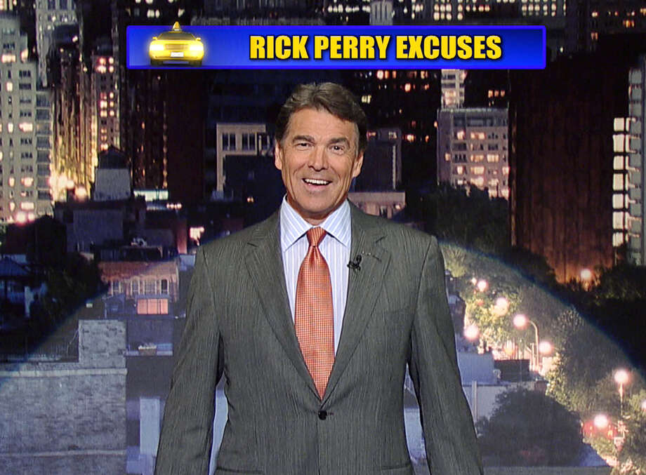 """In this image taken from video and provided by Worldwide Pants, Inc., Republican presidential candidate Rick Perry presents the """"Top Ten Rick Perry Excuses,"""" on the set of the ÀLate Show with David Letterman,À Thursday, Nov. 10, 2011 in New York. (AP Photo/Worldwide Pants, Inc. via CBS) Photo: AP / Worldwide Pants Inc. via CBS"""