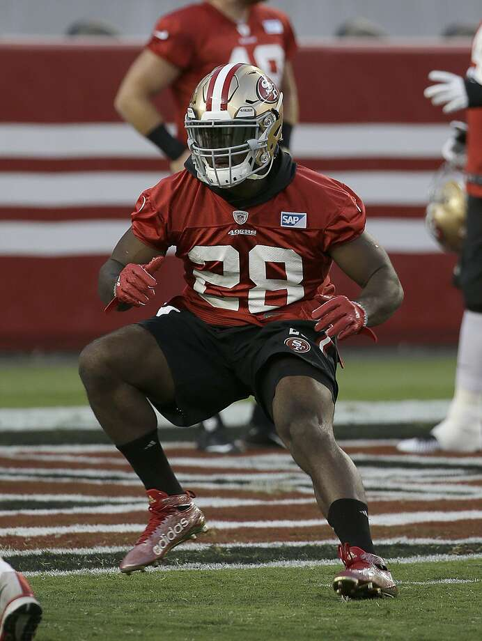 Running back Carlos Hyde is tasked with replacing longtime 49er Frank Gore, who moved to Indianapolis. Photo: Jeff Chiu, Associated Press