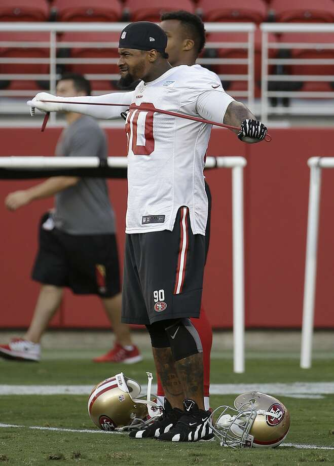 Defensive tackle Darnell Dockett is part of a group of older players that 49ers head coach Jim Tomsula says he doesn't want to tire out when meaningful games are still a month away. Photo: Jeff Chiu, Associated Press