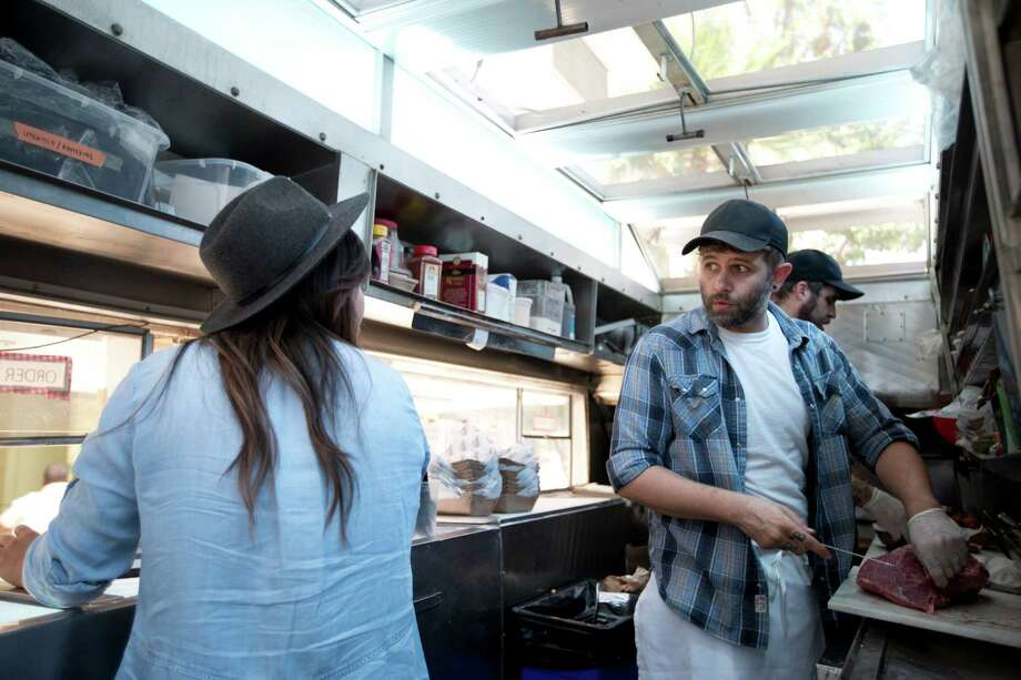Food truck owners Ryan Lamon and wife Diana chat while getting ready for business in Burbank, Calif. The health care law, minimum wage increases and paid sick leave laws in some states and cities are increasing costs for the Lamons and other business owners. Photo: Jae C. Hong /Associated Press / AP