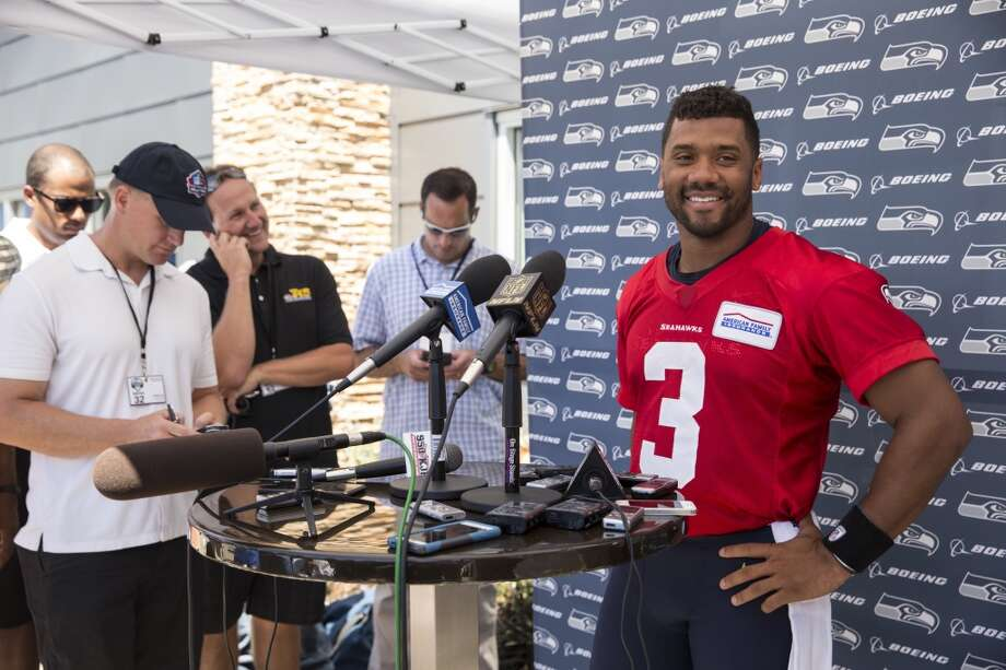 "What were your initial thoughts on the Russell Wilson deal? Corry: ""It was in the neighborhood of where I expected it to be, because I had written an article in early June for CBS on what I thought a fair deal would be, and I had it at $89 million over four, $62.5  million in guarantees and also a $25 million signing bonus. So him getting  a $30 million signing bonus and coming in a shade under that -- that's what  I thought would be something both sides could live with."" Photo: Stephen Brashear, Associated Press"