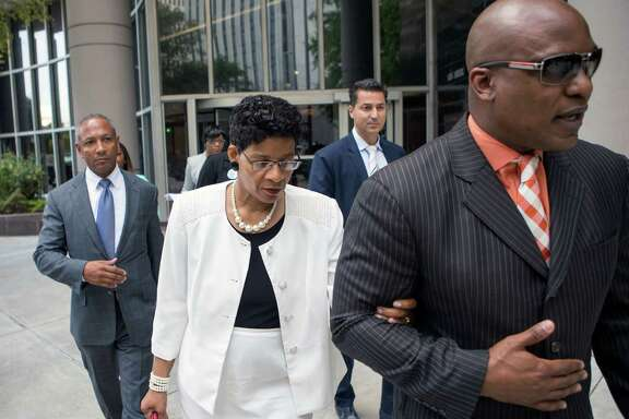 Sandra Bland's mother, Geneva Reed-Veal, walks with attorney Cannon Lambert at the federal courthouse.