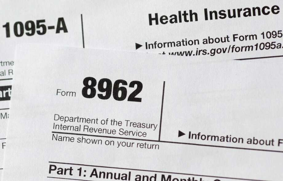 In this Aug. 21, 2014 file photo, tax form 8962 is seen in Washington. About 1.8 million households that got financial help for health insurance under President Barack Obama's law have issues with their tax returns that could jeopardize their subsidies next year.FILE - This Aug. 21, 2014, file photo, shows health care tax forms 8962 and1095-A, in Washington.  (AP Photo/Carolyn Kaster, File) Photo: Carolyn Kaster, STF / AP