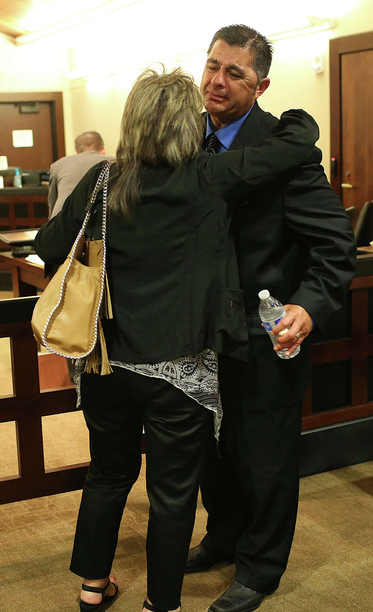 Victim Jacques Gonzales is hugged by his sister, Cynthia Garibay Molina after testifying at the attempted murder trial of Adolph Ramos Suarez in the 379th State District Court at the Cadena-Reeves Justice Center, Tuesday, August 4, 2015. Suarez is accused of shooting Gonzales three times in a road rage incident at the 800 block of Utopia Lane in May 2012. Witnesses told police Suarez first shot him in the head and then walked over to Gonzales as he lay in the street and shot him two more times.