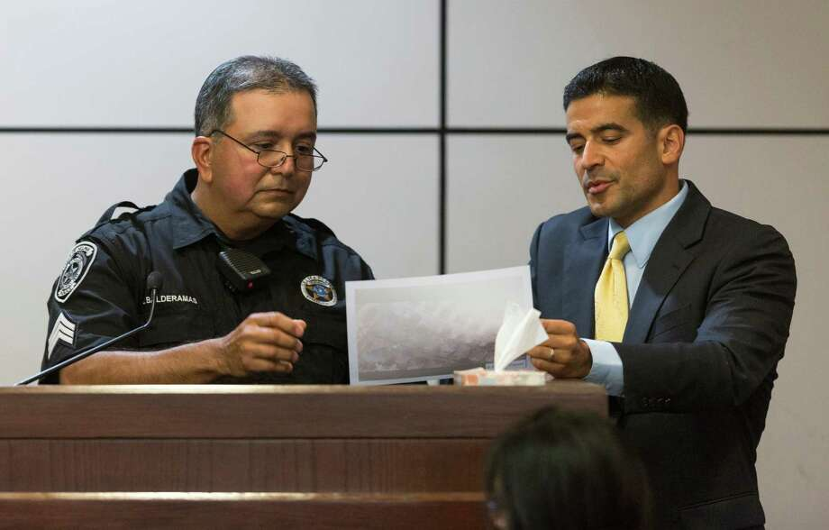 District Attorney Nicholas LaHood presents documents Tuesday, Aug. 4, 2015 as the lead prosecutor to witness Sgt. Jesse Balderamos during Jessie Hernandez Jr.'s trial on charges related to the shooting of two Selma police officers in September 2013. Balderamos is one of the two officers shot. Hernandez is a former cop himself, who worked for the Corpus Christi and Robstown departments. Photo: William Luther, Staff / San Antonio Express-News / © 2015 San Antonio Express-News