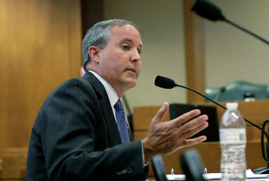 Texas Attorney General Ken Paxton testifies during a Texas Senate Health and Human Services Committee hearing on Planned Parenthood videos covertly recorded that target the abortion provider, Wednesday, July 29, 2015, in Austin, Texas. Texas is one of a number of GOP-controlled states that have launched investigations after the release of videos in which Planned Parenthood officials discuss how to harvest tissue for research from aborted fetuses.  (AP Photo/Eric Gay) Photo: Eric Gay, STF / AP