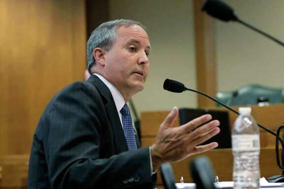 Texas Attorney General Ken Paxton testifies during a Texas Senate Health and Human Services Committee hearing on Planned Parenthood videos covertly recorded that target the abortion provider, Wednesday, July 29, 2015, in Austin, Texas. Texas is one of a number of GOP-controlled states that have launched investigations after the release of videos in which Planned Parenthood officials discuss how to harvest tissue for research from aborted fetuses.  (AP Photo/Eric Gay)