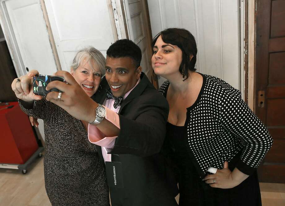 Left to right: Jeri Boomgaarden, Dawn Robinson and Sarah Merkele take a selfie after Robinson tries on a suit at Saint Harridan in Oakland, Calif., on Monday, August 3, 2015. Photo: Liz Hafalia, The Chronicle