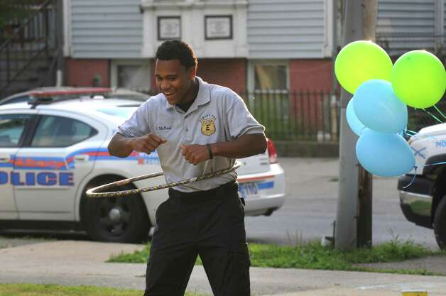 Albany PAL explorer Jomeer McNeal hula hoops during National Night Out in Pine Hills Park on Tuesday Aug. 4, 2015 in Albany, N.Y. (Michael P. Farrell/Times Union) Photo: Michael P. Farrell / 10032864A