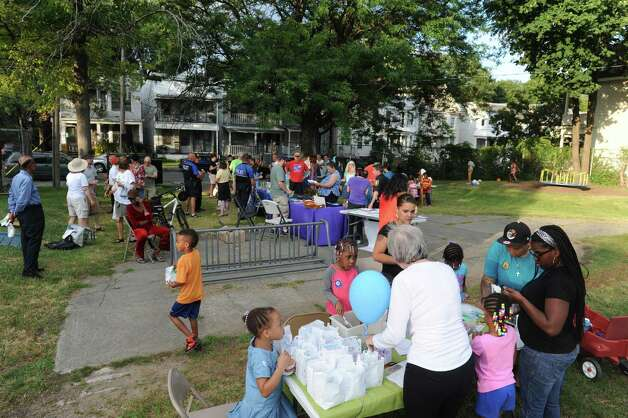 Neighbors gather to take part in National Night Out in Pine Hills Park on Tuesday Aug. 4, 2015 in Albany, N.Y. (Michael P. Farrell/Times Union) Photo: Michael P. Farrell / 10032864A