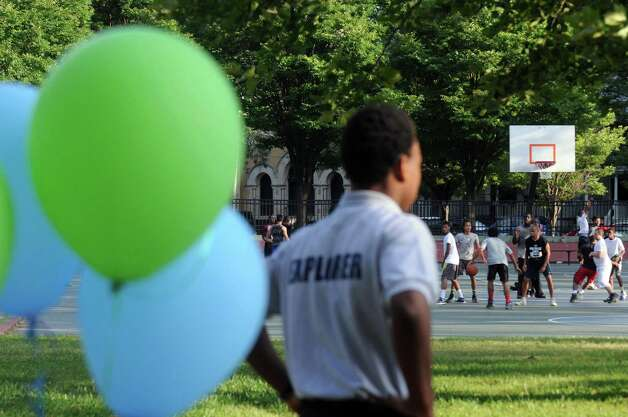 A large pickup game of basketball takes place during National Night Out in Pine Hills Park on Tuesday Aug. 4, 2015 in Albany, N.Y. (Michael P. Farrell/Times Union) Photo: Michael P. Farrell / 10032864A