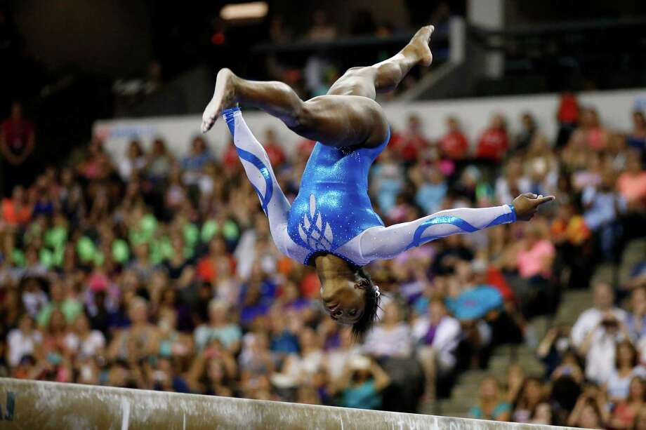 Simone Biles competes on the balance beam during the U.S. Classic gymnastics meet July 25. Photo: Andrew Nelles, FRE / FR170974 AP