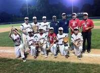The Greenwich Cannons 15-under team celebrates its 6-1 win over Norwalk for Sharkey Laureno Tournament championship at Cubeta Stadium in Stamford on August 4, 2015.
