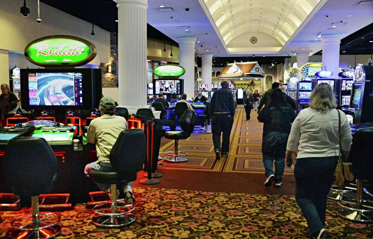 Gamblers try their luck at video gaming at Saratoga Casino and Raceway Tuesday, April 22, 2014, in Saratoga Springs, N.Y. New York state as quietly commissioned a study in 2019 to look at all the state's forms of gambling, which worries operators. (John Carl D'Annibale / Times Union archive)