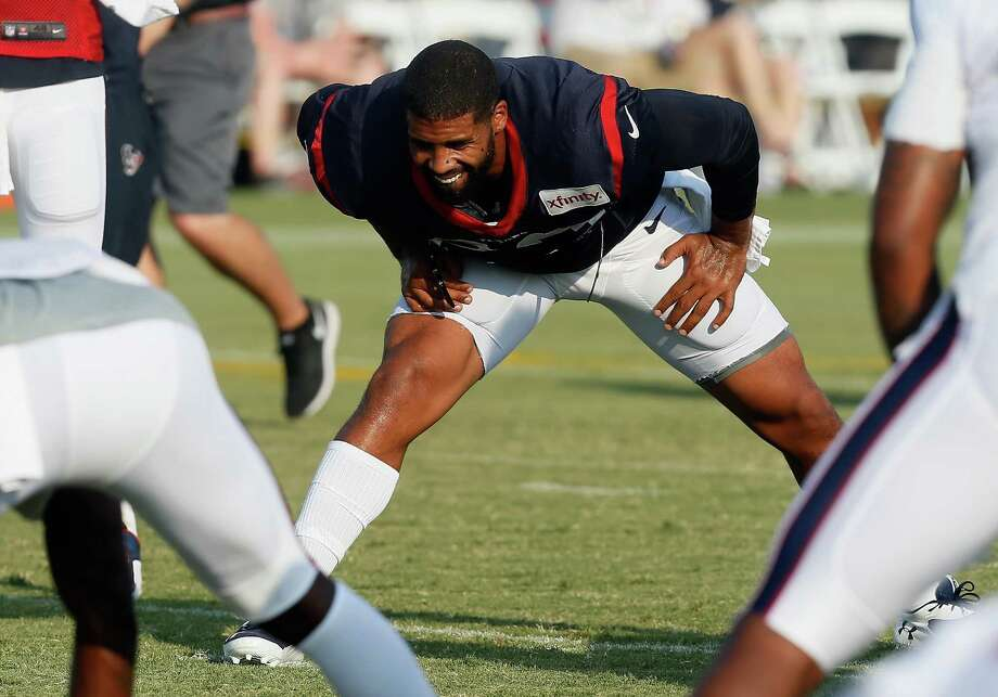 Houston Texans running back Arian Foster (23) stretches during an NFL football training camp at the Methodist Training Center on Monday, Aug. 3, 2015 in Houston. Photo: Bob Levey /Associated Press / FR156786 AP