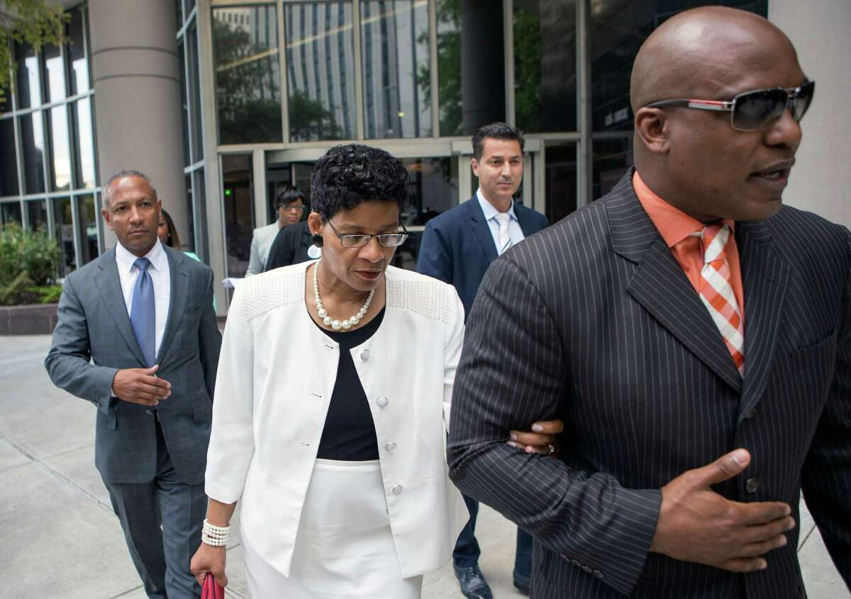 Sandra Bland's mother, Geneva Reed-Veal, center, walks with attorney Cannon Lambert, right, as they leave the Federal Courthouse, Tuesday, Aug. 4, 2015, in Houston. Reed-Veal filed a federal lawsuit Tuesday against the Texas Department of Public Safety trooper and several others she deems responsible for the death of her 28-year-old daughter at the Waller County Jail in mid-July. She is seeking a jury trial and unspecified monetary damages in her wrongful death suit against DPS trooper Brian Encinia; Waller County jail screening officers Elsa Magnus and Oscar Prudente; Waller County; and DPS.