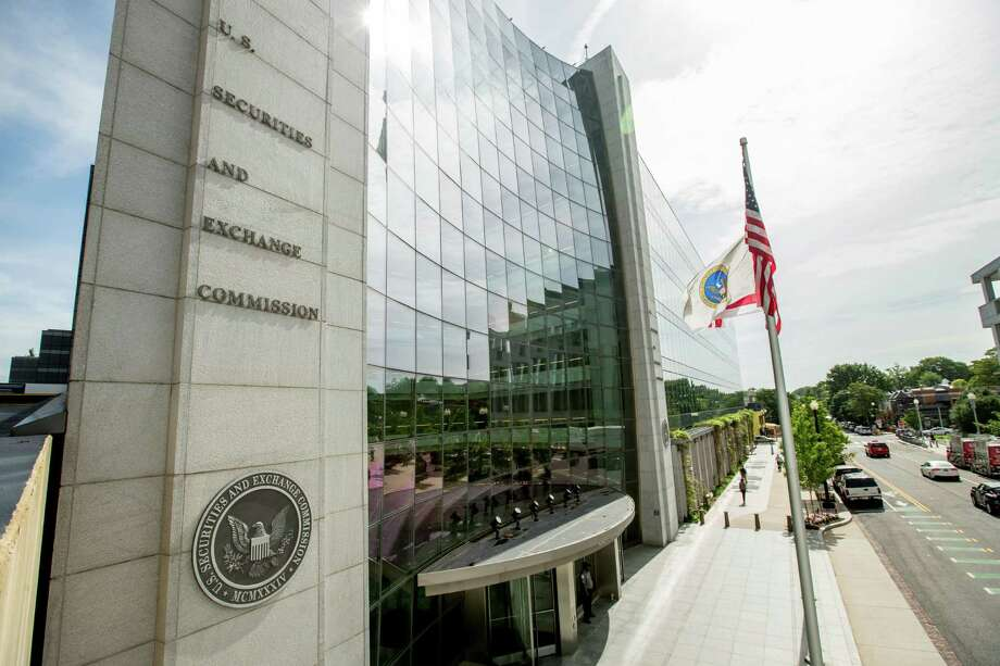 This June 19, 2015 photo shows the U.S. Securities and Exchange Commission building, in Washington. The Securities and Exchange Commission is scheduled to vote Wednesday, Aug. 5, 2015, to formally adopt a rule compelling public companies to report the ratio between their chief executive's annual compensation and the median, or midpoint, pay of employees. (AP Photo/Andrew Harnik) Photo: Andrew Harnik, STF / AP