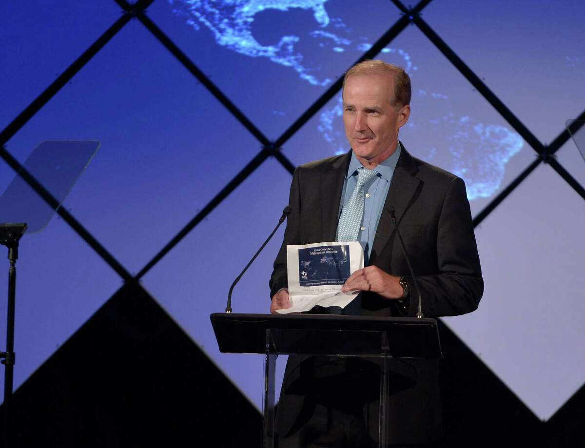 Former NRG chief David Crane speaks at a green energy event last year in Santa Monica, Calif. He says Wall Street has trouble with companies going green.