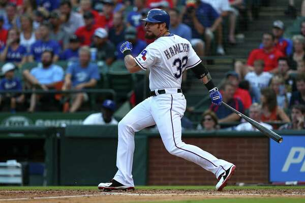 ARLINGTON, TX - AUGUST 04: Josh Hamilton #32 of the Texas Rangers hits a single in the second inning during a game against the Houston Astros at Globe Life Park in Arlington on August 4, 2015 in Arlington, Texas.