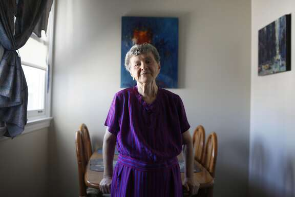 "Arsina Rabichev, 88, poses inside her apartment on Aug. 3, 2015.  Rabichev and thirteen other elderly and disabled face eviction from the San Francisco Housing Authority pending a plan to renovate their building.  Despite having been told they'll have temporary housing elsewhere, Rabichev fears that there's no guarantee they'll be able to move back home.  ""They want to turn the house into a big business.  We can only pay 200 [a month], not 2000."""