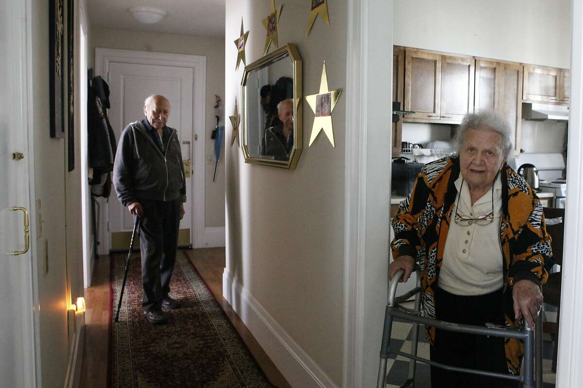 Zinovy Gornitsky, 93, and his wife, Berta, pose within their Eddy street apartment on Monday, Aug. 3, 2015. Residents of the building for 30 years they fear that they will be evicted by the San Francisco Housing Authority pending renovations planned to take place.