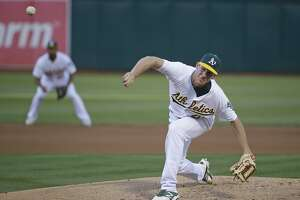 Chris Bassitt gets run support and 1st win with A's - Photo