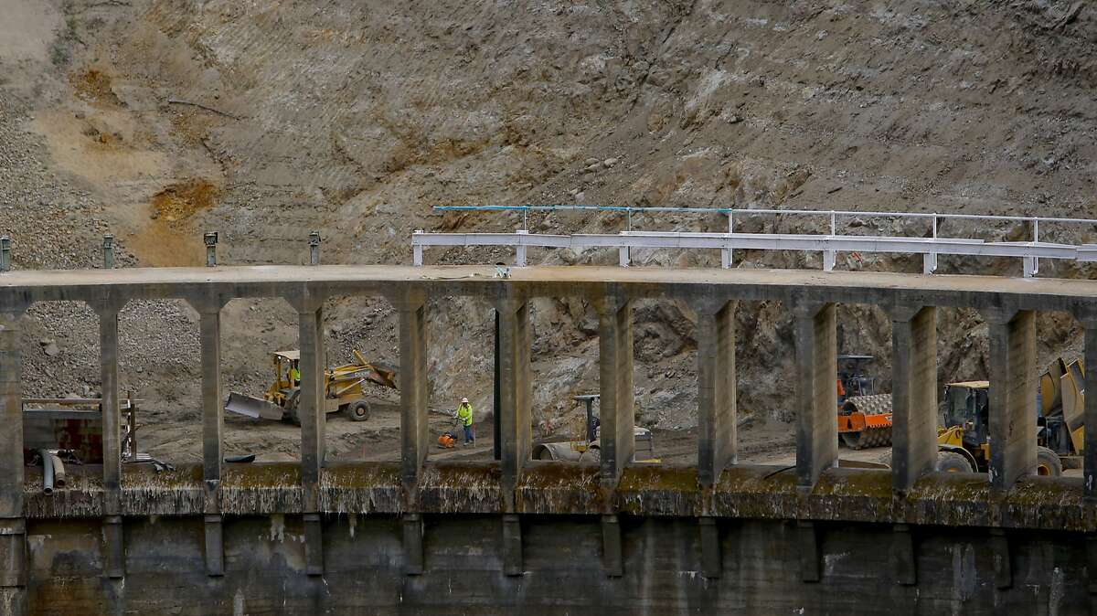 Workers are seen through the top of the dam as the demolition of the San Clemente Dam continues in Carmel Valley, California, as seen on Tues. August 4, 2015.
