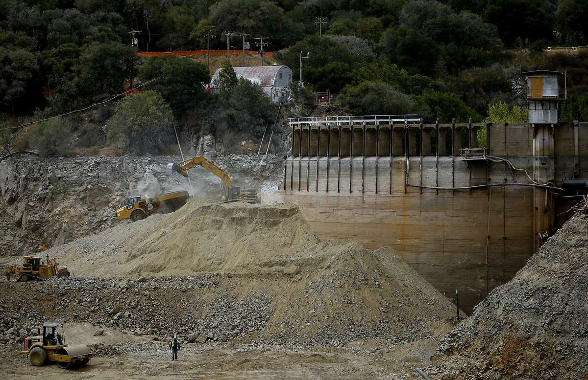 Workers continue the demolition of the San Clemente Dam in Carmel Valley, California, as seen on Tues. August 4, 2015.