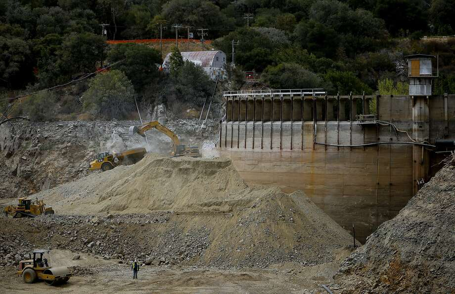 Workers continue the demolition of the San Clemente Dam in Carmel Valley, California, as seen on Tues. August 4, 2015. Photo: Michael Macor, The Chronicle