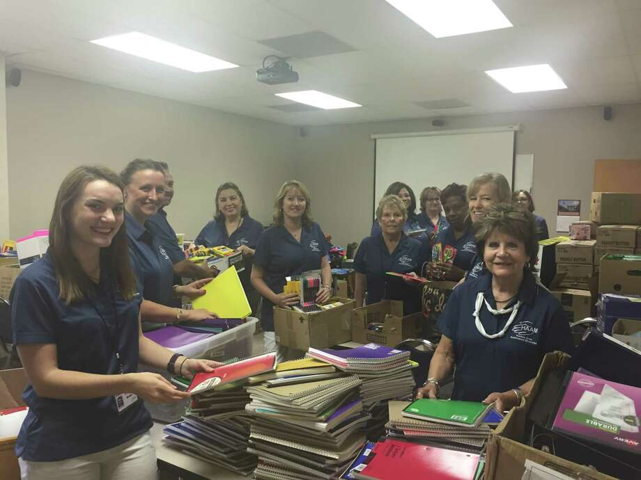 Humble Area Assistance Ministries staff work sorting school supplies for the nonprofit's Back to School program. Photo: Courtesy