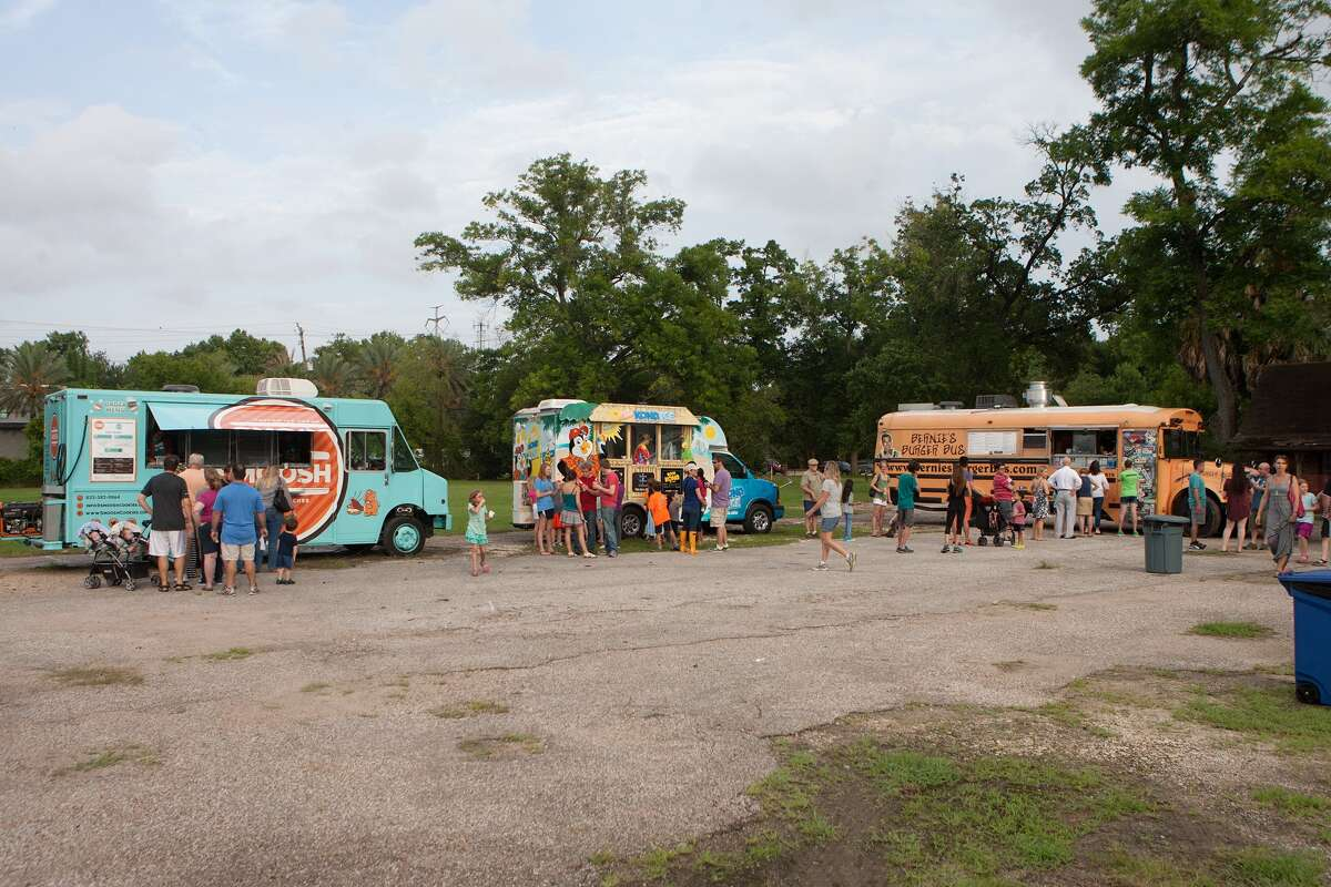 A five-truck impromptu food court set up during the groundbreaking ceremony and celebration for Evelyn's Park.