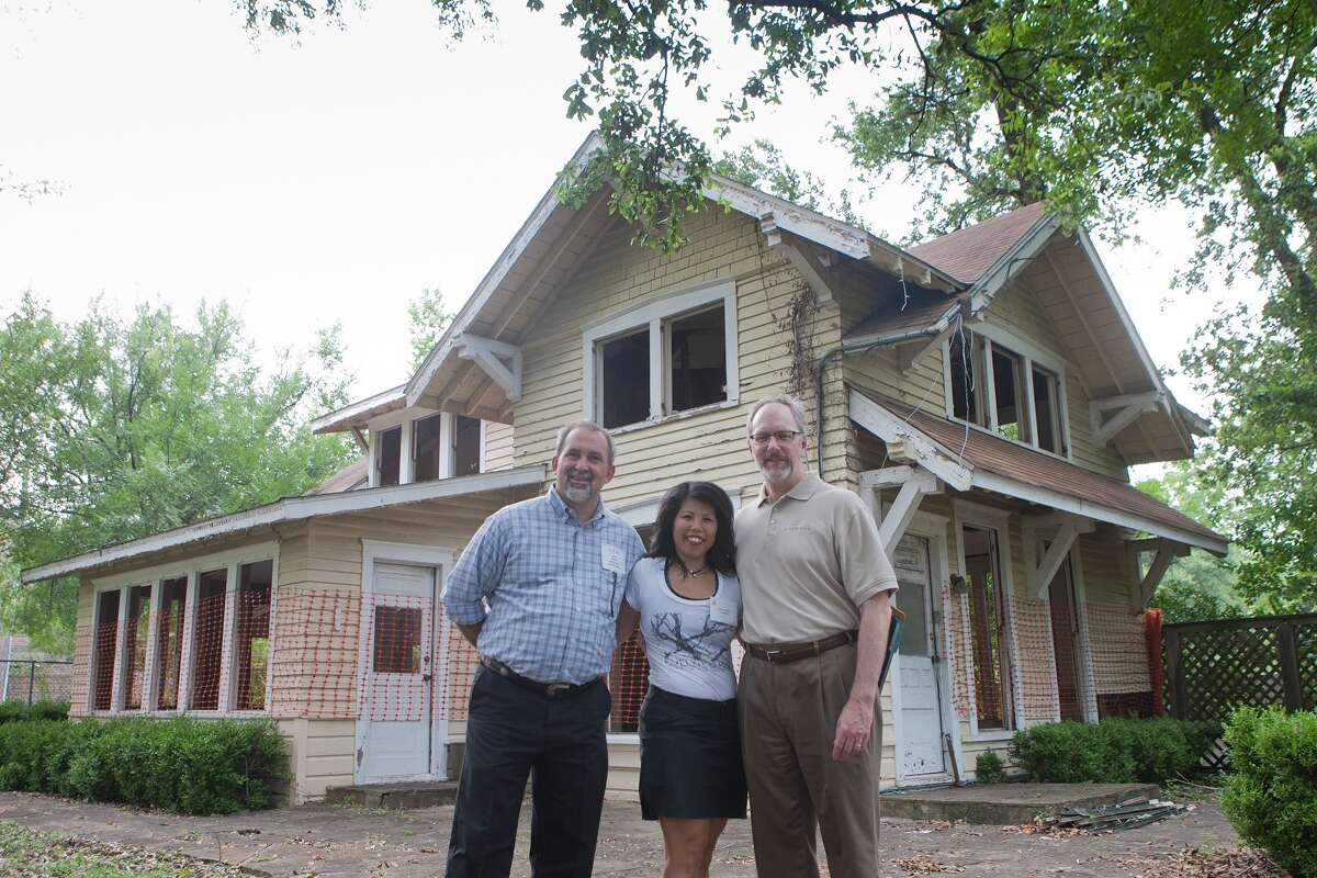 Karl Miller of Bellaire Parks and Recreation, left, Patricia King-Ritter, president of Evelyn's Park Conservancy and Tom Butler, of the Linbeck Group, stand in front of the yellow house this summer. The Teas family home was constructed in 1910. It was to be the site of a café in the park but was deemed to be cost prohibitive and was demolished in late July. Karl Miller of Bellaire Parks and Recreation, left, Patricia King-Ritter, president of Evelyn's Park Conservancy and Tom Butler, of the Linbeck Group, stand in front of the yellow house this summer. The Teas family home was constructed in 1910. It was to be the site of a café in the park but was deemed to be cost prohibitive and was demolished in late July.