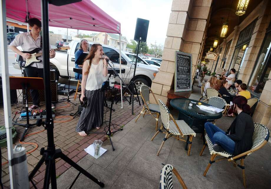 LN and the Crush perform outside Katharine and Company during First Thursday on April 2, 2015. Shops and restaurants along Calder Avenue kept their doors open and the music pumping for First Thursday. Photo taken Thursday 4/2/15 Jake Daniels/The Enterprise Photo: Jake Daniels/The Enterprise