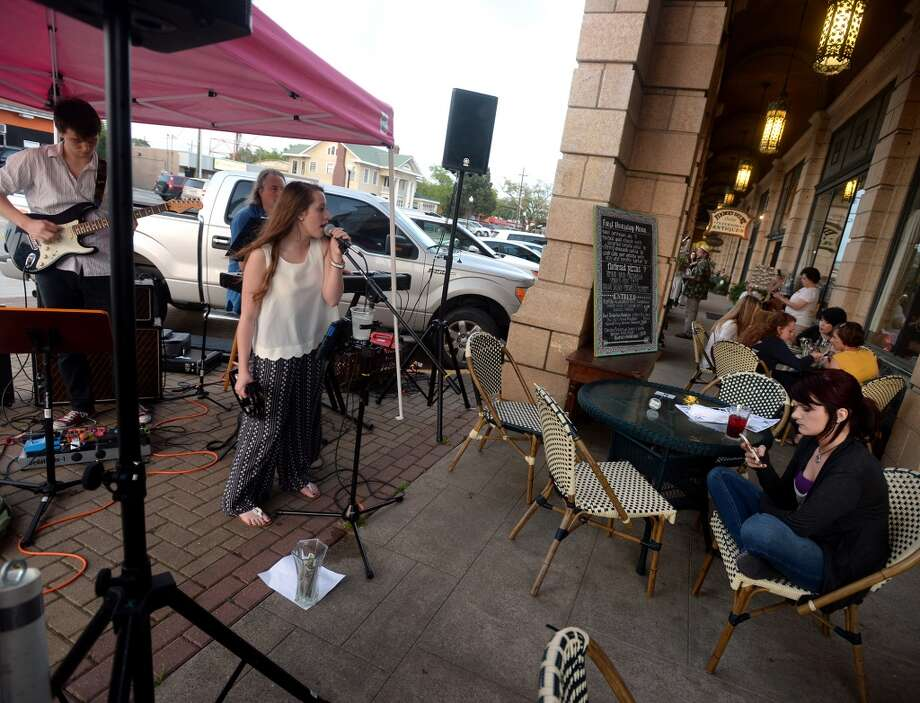 LN and the Crush perform outside Katharine and Company on Thursday. Shops and restaurants along Calder Avenue kept their doors open and the music pumping for First Thursday. Photo taken Thursday 4/2/15 Jake Daniels/The Enterprise Photo: Jake Daniels/The Enterprise